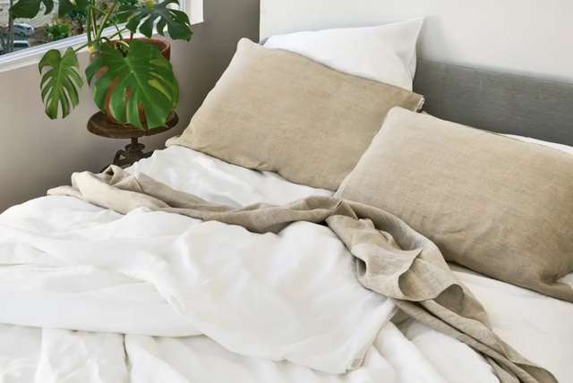hemp bedding on a bed next to a plant
