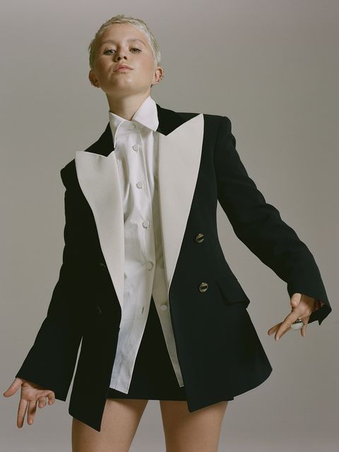 Clothing, Suit, Formal wear, Outerwear, Tuxedo, Fashion, Coat, Uniform, Blazer, Jacket,