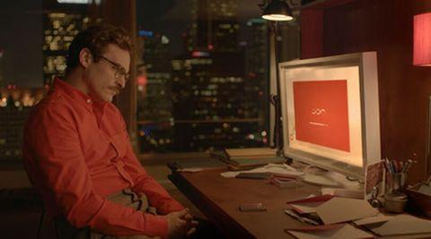 joaquin phoenix staring at a computer screen