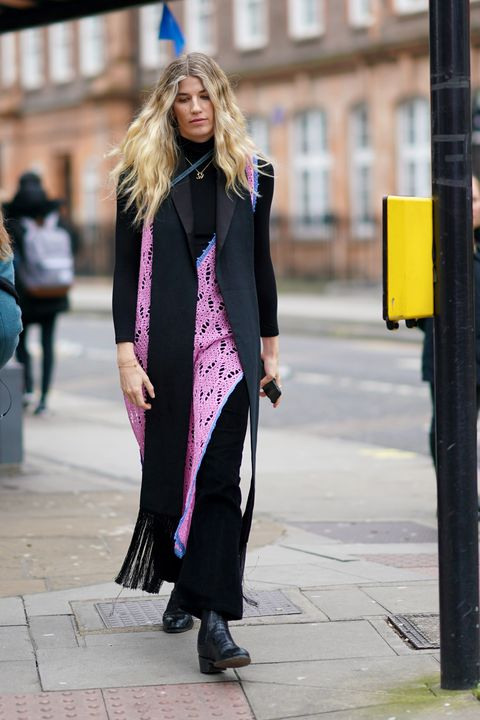 london, england   february 17 veronika heilbrunner wears a black pullover, a long scarf, a pink dress, a necklace, during london fashion week february 2020 on february 17, 2020 in london, england photo by edward berthelotgetty images