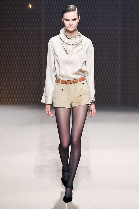 Fashion model, Fashion show, Fashion, Clothing, Runway, Fashion design, Knee, Beige, Human, Public event,