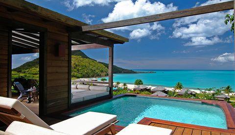 Property, Resort, Real estate, House, Vacation, Room, Swimming pool, Azure, Building, Ocean,