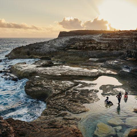 Body of water, Sky, Sea, Water, Ocean, Rock, Coast, Cloud, Natural landscape, Coastal and oceanic landforms,
