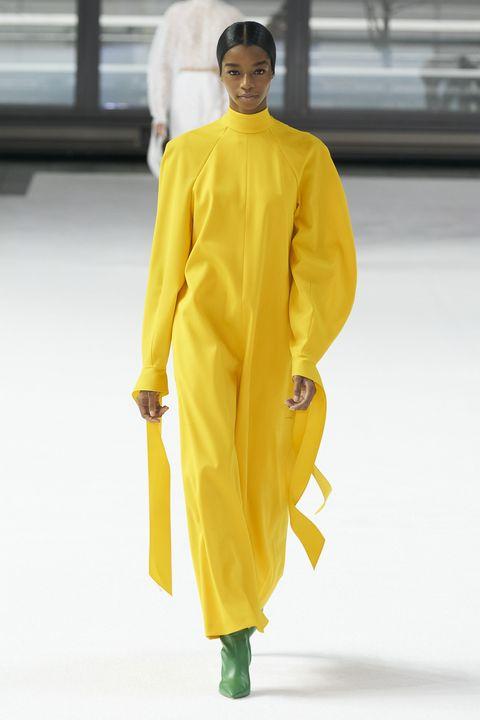 Yellow, Clothing, Fashion, Outerwear, Fashion model, Fashion show, Fashion design, Formal wear, Neck, Runway,