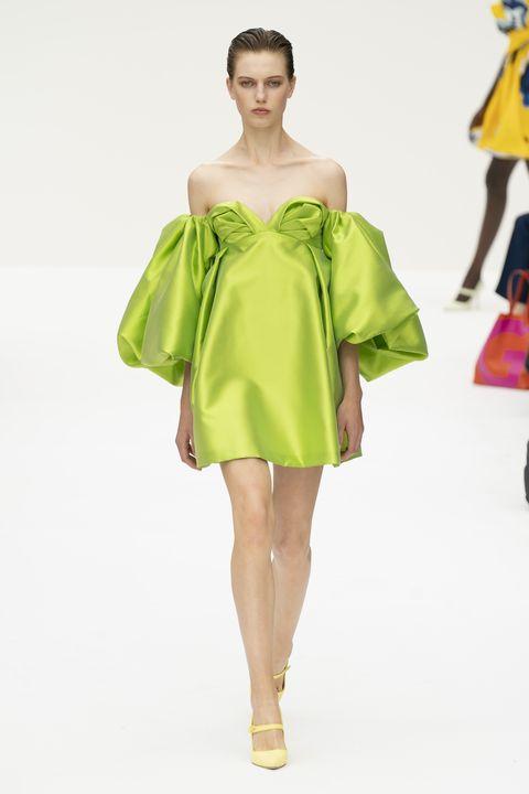 Fashion model, Clothing, Fashion, Shoulder, Green, Fashion show, Yellow, Joint, Dress, Runway,
