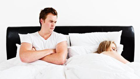 Couple trouble: he's awake and grumpy she's ignoring him