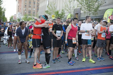 Footwear, Athletic shoe, Crowd, Shorts, Active shorts, Team, Pedestrian, Calf, Athlete, Outdoor shoe,