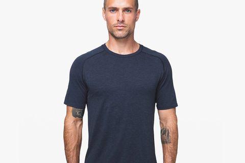 a man wearing a navy workout shirt