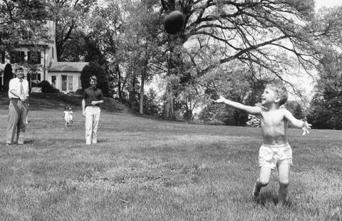 sen john kennedy l throwing football to his nephew bobby jr as his bro robert looks on, in his yard at hickory hill home