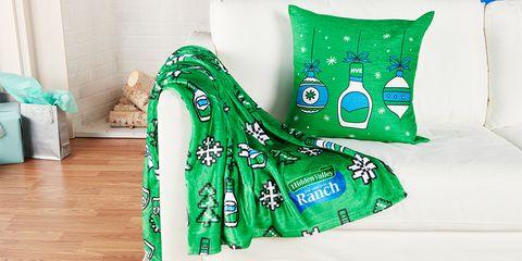Green, Font, Textile, Pillow, Furniture, Plant, Linens, Fashion accessory, Cushion, Games,