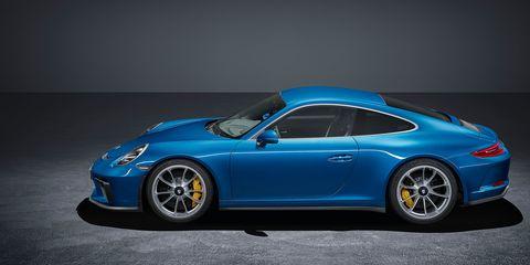 Land vehicle, Vehicle, Car, Supercar, Sports car, Cobalt blue, Automotive design, Performance car, Porsche, Rim,