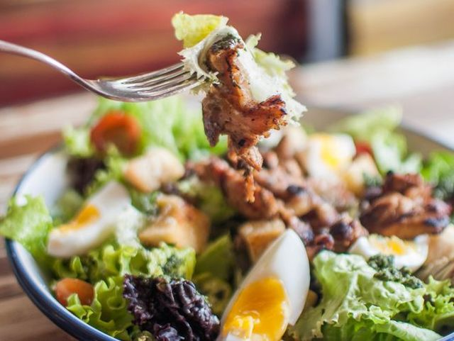 A high-angle close-up view of a salad in a bowl