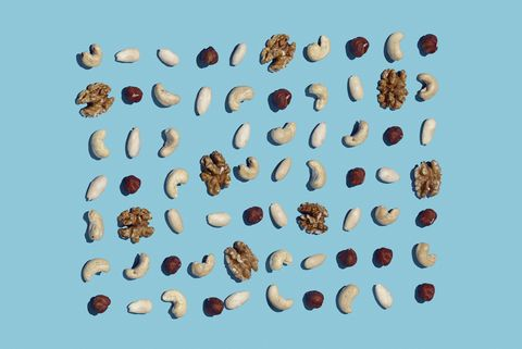 High angle view of nuts on blue background