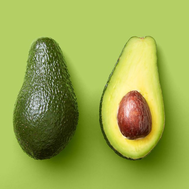 High Angle View Of Avocado Over Green Background
