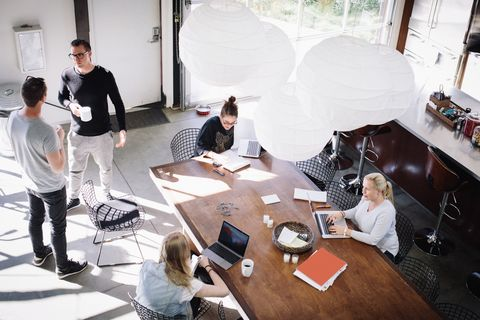 high angle view of business people working in creative office on sunny day