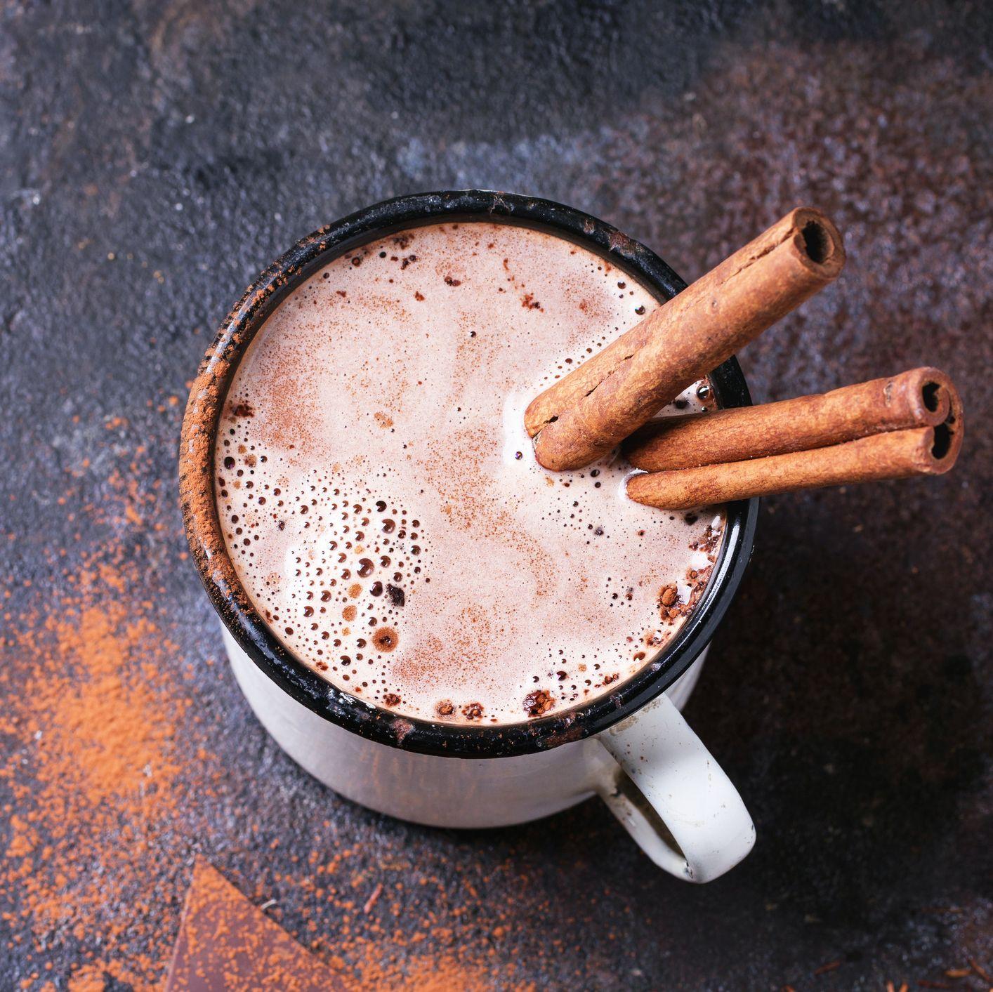 High Angle View Of Cinnamon Sticks In Coffee