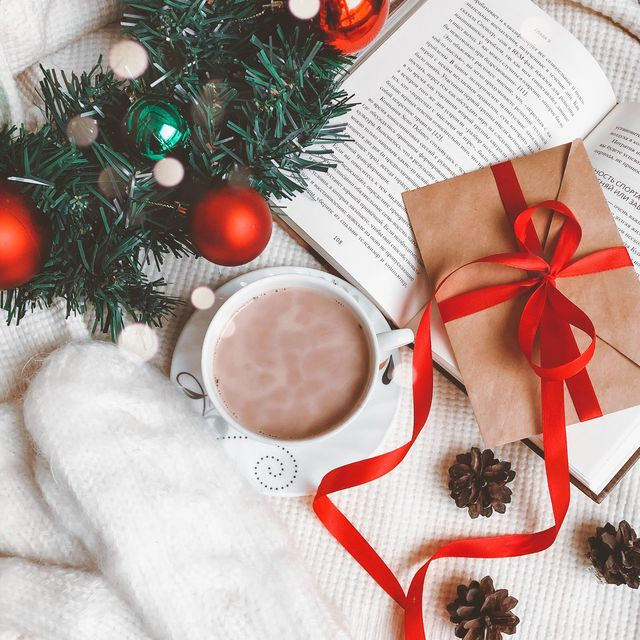high angle view of coffee with book and christmas decoration on table