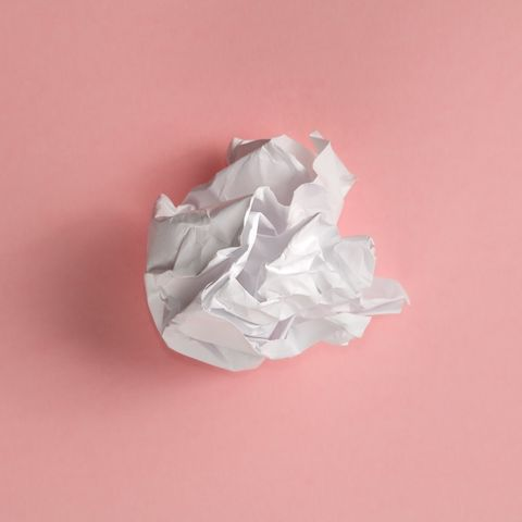 High Angle View Of Crumpled Paper Over Pink Background