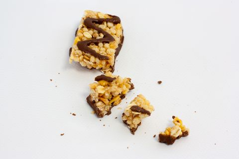 high angle view of crunchy granola bar against white background