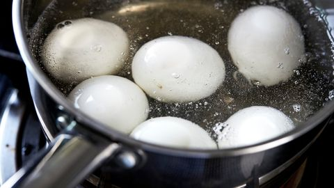 High Angle View Of Eggs Boiling In Water
