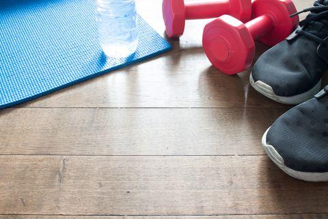 high angle view of fitness equipment on hardwood floor