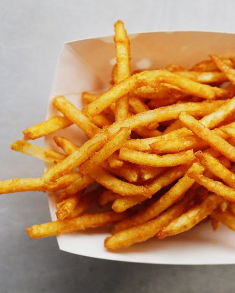 high angle view of french fries in box on table