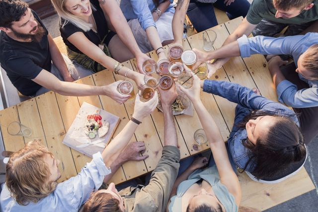 high angle view of friends toasting in bar
