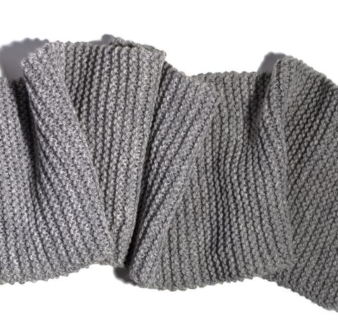 high angle view of gray woolen scarf on white background