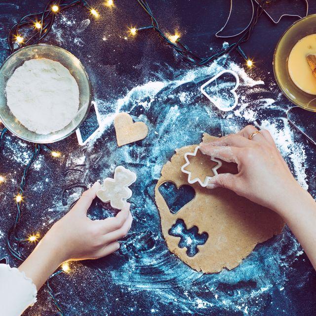 christmas activities   high angle view of hands making christmas cookies