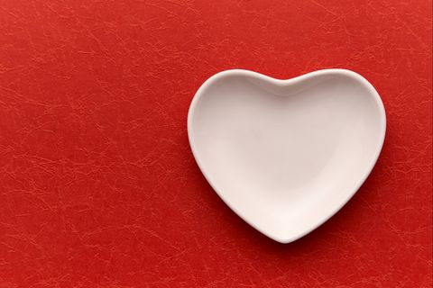 High Angle View Of Heart Shape Container On Table