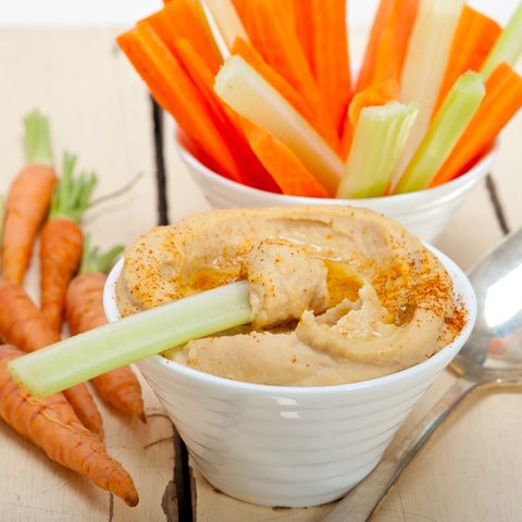 high angle view of hummus and carrots on table
