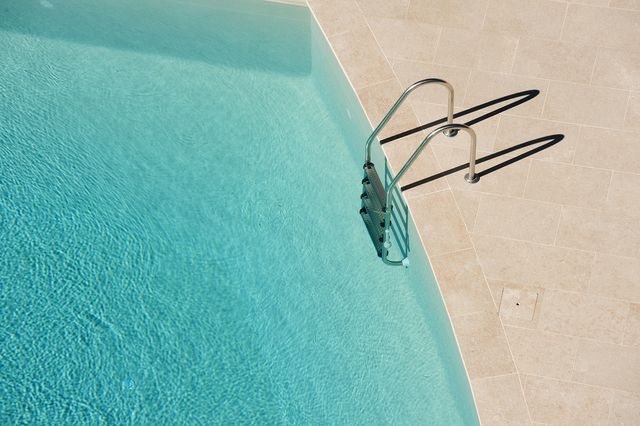 high angle view of ladder on swimming pool
