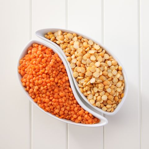 High Angle View Of Lentils And Split Peas In Bowls On Table