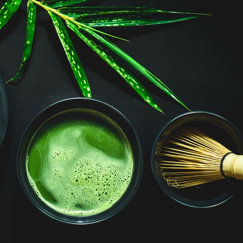 High Angle View Of Matcha Tea Against Black Background