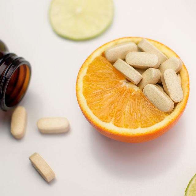 high angle view of orange slices with medicines on table