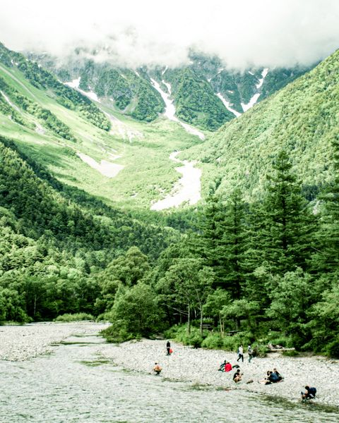high angle view of people by river and mountains