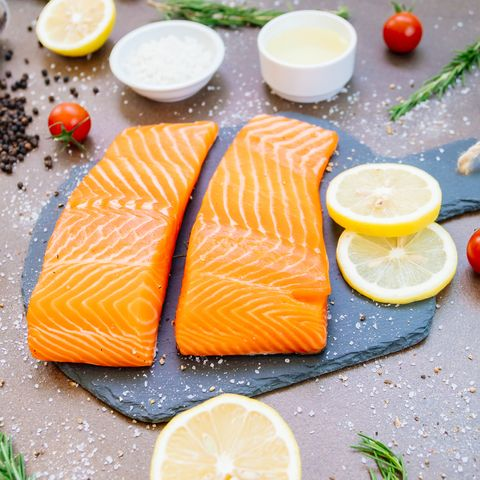 High Angle View Of Salmon On Cutting Board With Ingredients