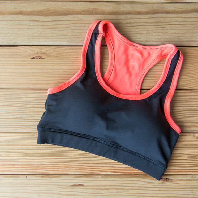 High Angle View Of Sports Bra On Wooden Table