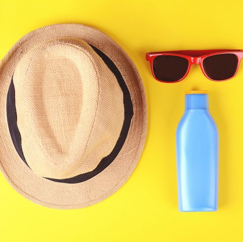 high angle view of sunglasses and hat against yellow background