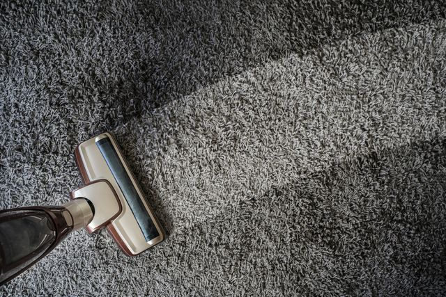 high angle view of vacuum cleaner cleaning carpet at home