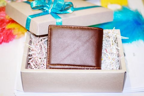 high angle view of wallet in gift box on table