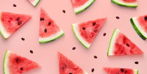 High Angle View Of Watermelon Slices Against Pink Background