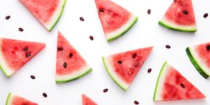 High Angle View Of Watermelon Slices Against White Background