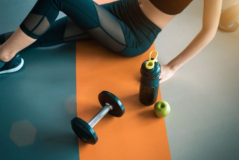 High Angle View Of Woman Exercising At Gym