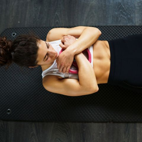 high angle view of woman exercising on floor at gym