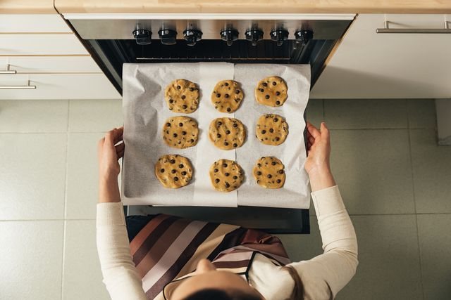 high angle view of woman preparing cookies in kitchen