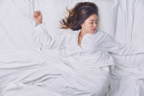 young beautiful asian woman hates waking up early in the morning