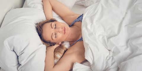 High Angle View Of Woman Sleeping On Bed