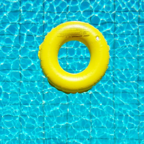 High Angle View Of Yellow Rubber Ring In The Pool