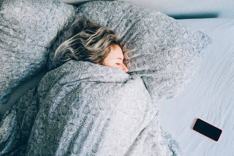 High Angle View Vie Of Woman Sleeping On Bed